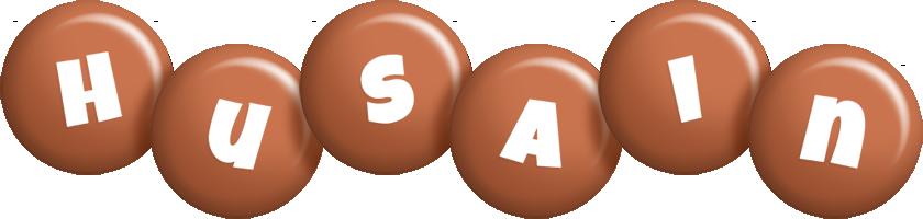Husain candy-brown logo