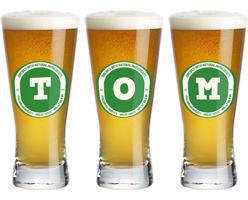 Tom lager logo